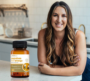 Jess Blair in her kitchen with natural supplement Supabee for Energy