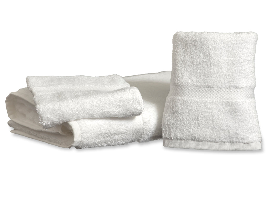 White Royal Suite by Thomaston Mills Bathmat with dobby border folded and stacked