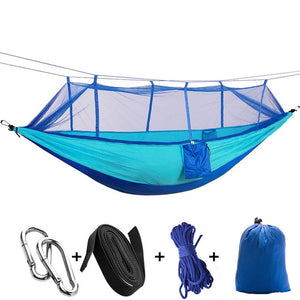 blue camping hammock with mosquito net