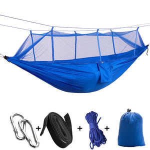 deep blue camping hammock with mosquito net
