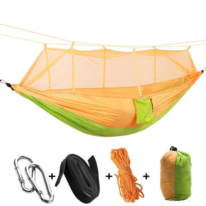yellow green camping hammock with mosquito net