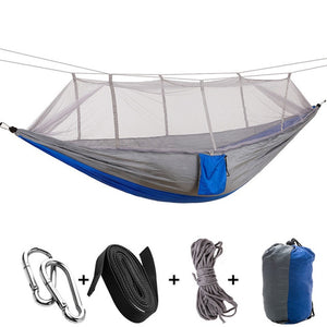 grey blue camping hammock with mosquito net