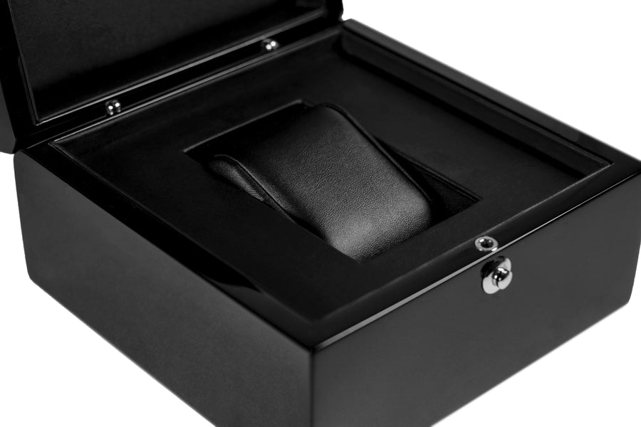 close up of leather lined interior, wooden watch box