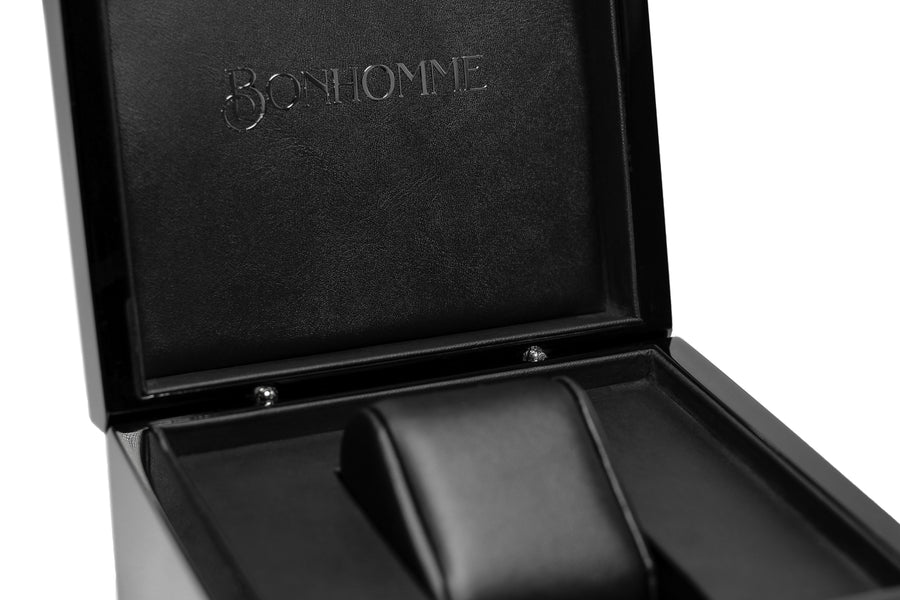 Black piano wood watch box with silver logo detail interior shot