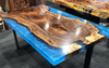 Claro Walnut Cast Dining Table with Metallic Blue Resin