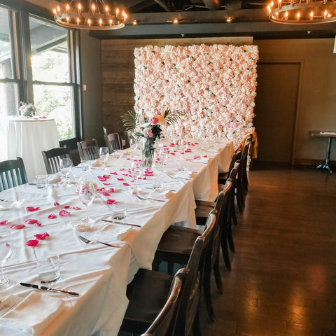 Rosé Designs YYC Pink Flower Wall at The Lake House