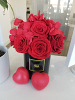Red Roses and Hydrangeas Bouquet in Black Vase