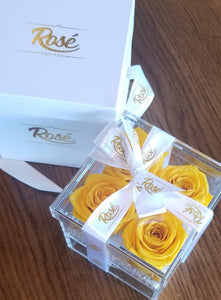 Four Yellow Eternal Roses in Clear Keepsake Box