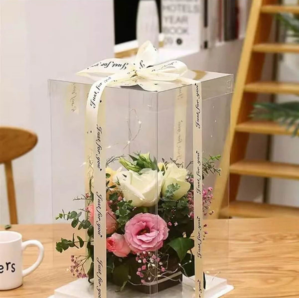Clear gift box with flower bouquet displayed