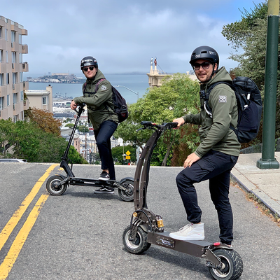 Founders of LAZYROLLING riding electric scooters in San Francisco