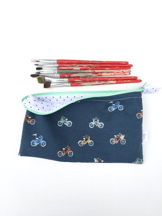 bicycles on navy zipper pouch