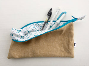 pencil pouch in straw with teal pintuck