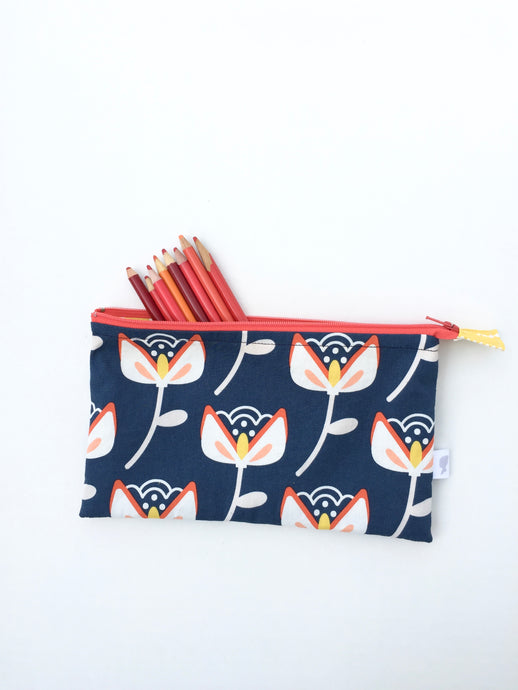 bold flower on navy zipper pouch