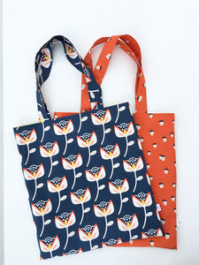bold flower on navy library tote