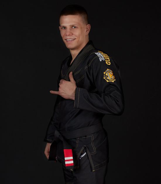 Front view of a Ground Game Champion 2.0 BJJ Gi Black