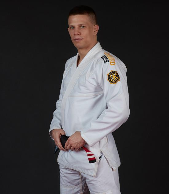 Side view of a Ground Game Champion 2.0 BJJ Gi White