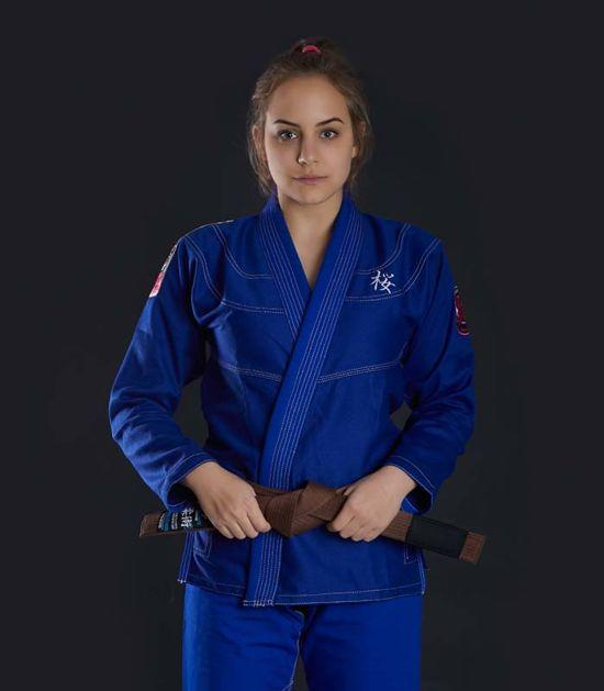 Front view of a Ground Game Sakura BJJ Women`s Gi Blue