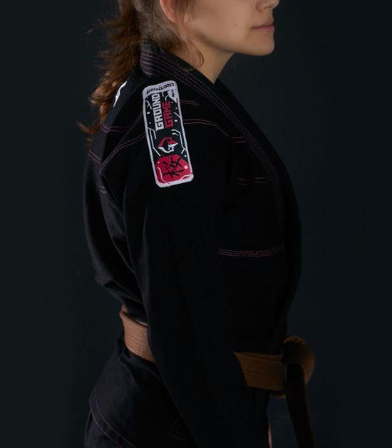 Left side view of a Ground Game Sakura BJJ Women`s Gi Black