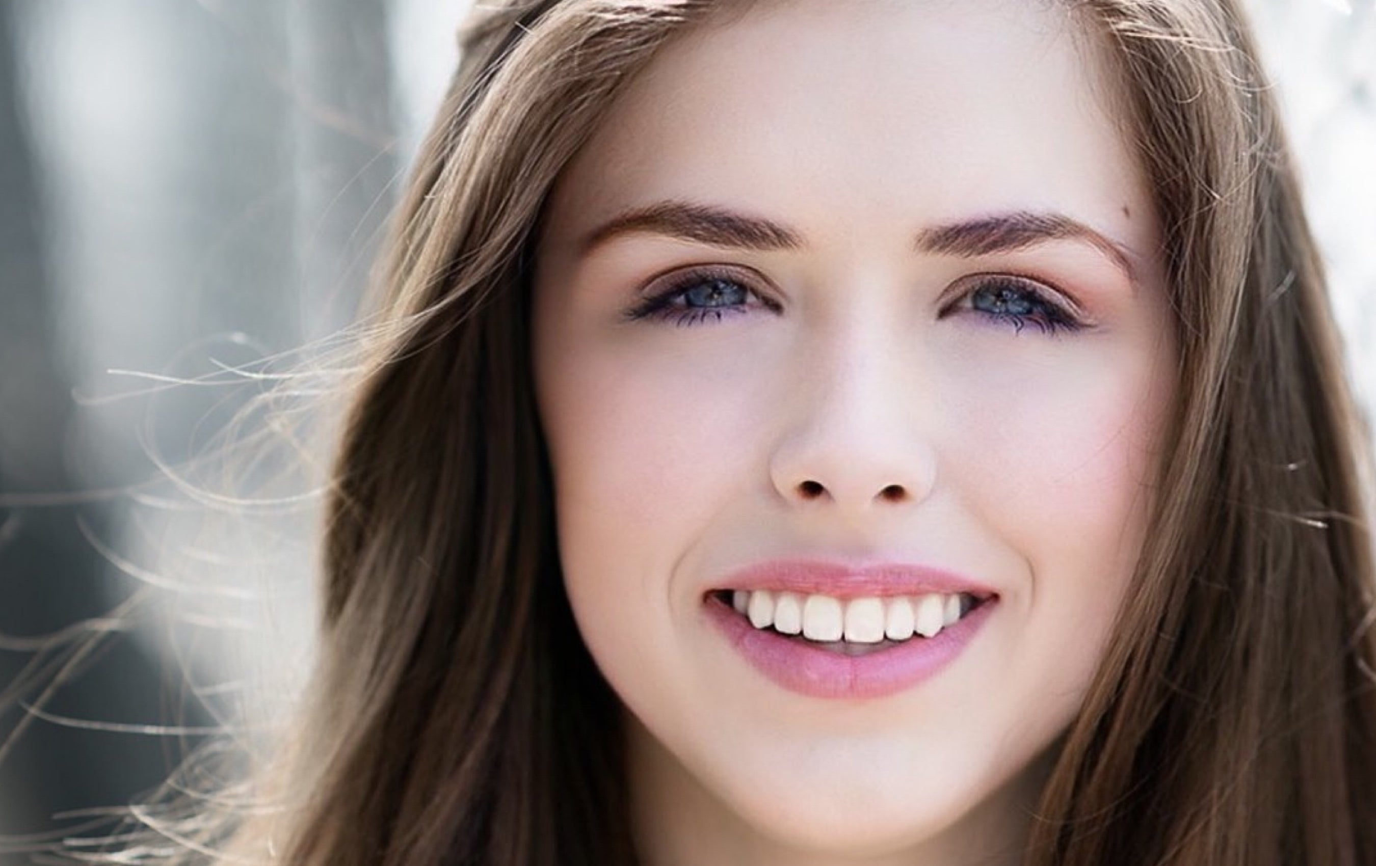 About us - photo of beautiful smiling young woman
