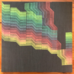 a two foot square piece of suit wool printed by Susana McDonnell of LinoCave using an angled line design in an ombre of rainbow colors.