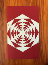 Load image into Gallery viewer, Hand block printed Moleskine Medium ruled chair journal in red. Printed in white ink on a geometric pattern.