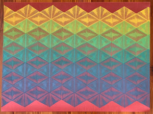 An original work of art by Susana McDonnell of LinoCave. Consists of a rainbow-colored ombre geometric pattern hand printed onto re red piece of silk.