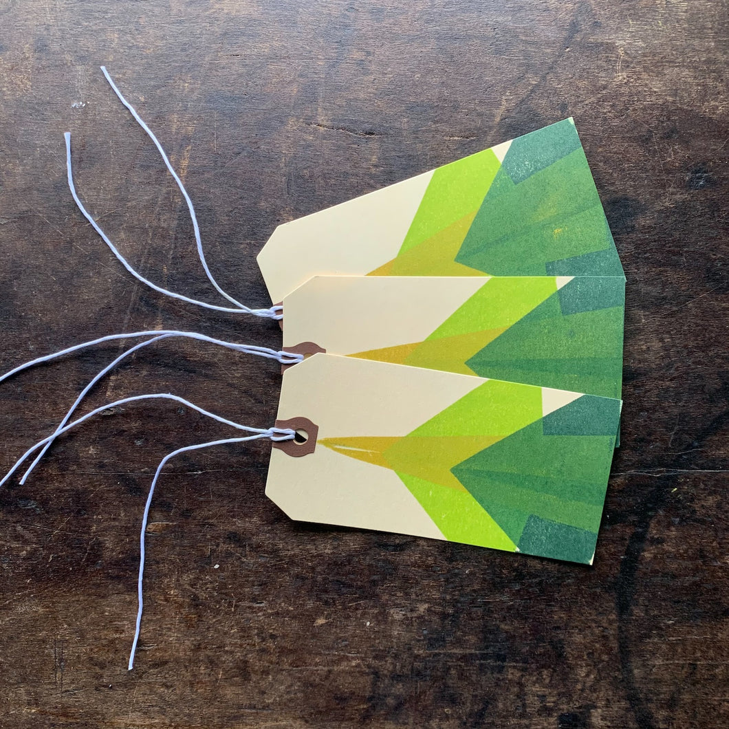 Set of three hand block printed gift tags with an abstract tree design in greens and yellow.