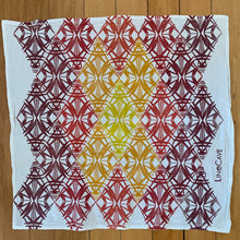Load image into Gallery viewer, A hand block printed white flour sack towel with am ombre of warm colors in a geometric pattern.