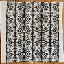 Load image into Gallery viewer, A hand block printed white flour sack towel in a black geometric pattern.