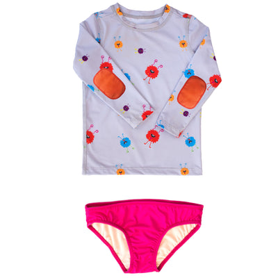 girls monster print swimshirt set has wacky monsters, orange elbow pads, and UPF 50 sun protection