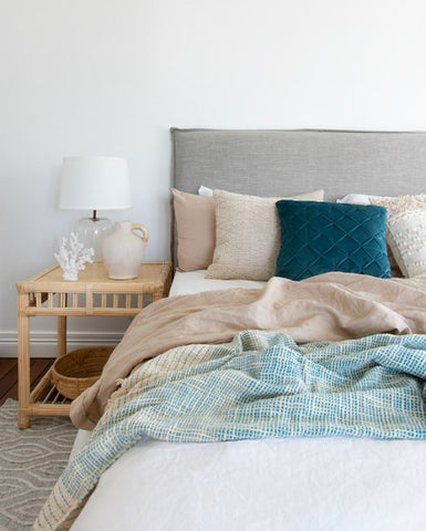 Beach house style bedroom inspiration with blues and greens