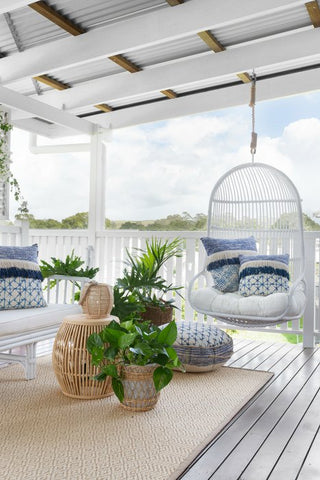 beach house style outdoor patio inspiration with white furniture and blue cushions