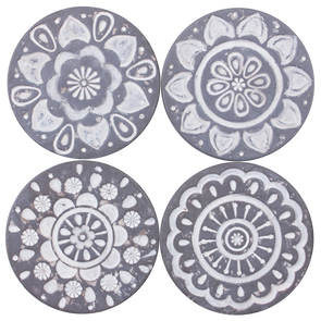 round grey coasters with floral design