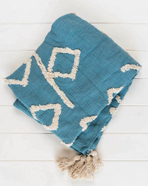 blue cotton throw rug with tassel detail