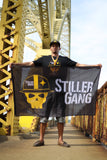 Man Holding Black Stiller Gang Flag (Pittsburgh Bridge)