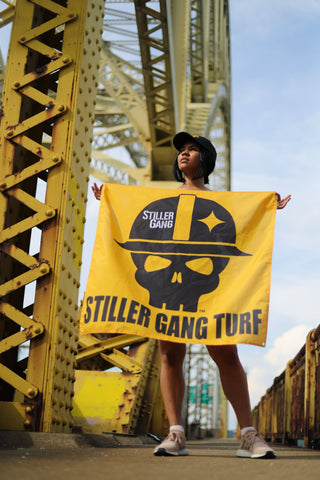 Woman Holding Gold Stiller Gang Flag (Pittsburgh Bridge)