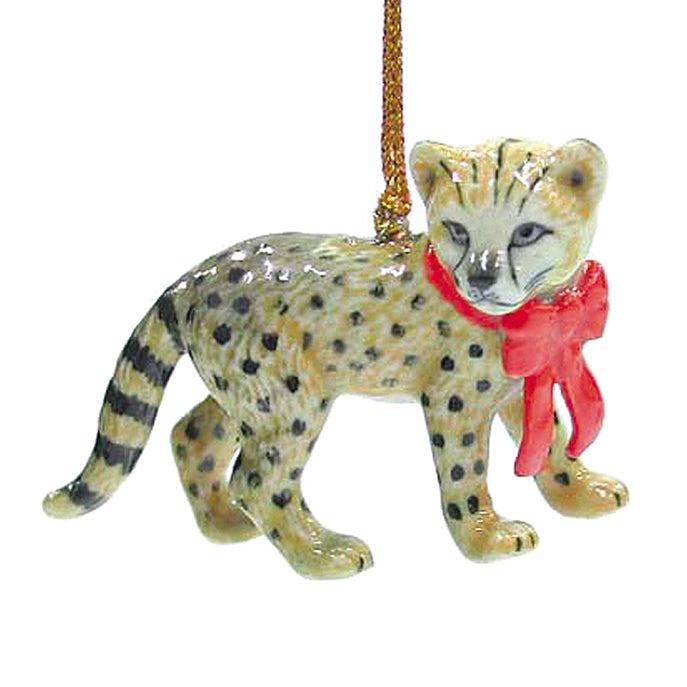 porcelain cheetah cat with red bow ornament