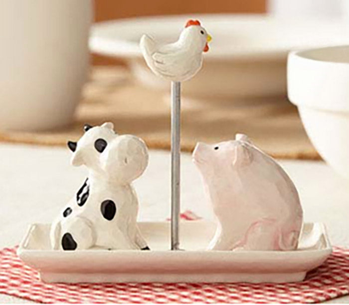 ceramic cow pig and chicken salt and pepper shakers on table