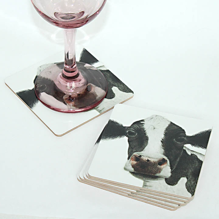 black and white cow coaster set
