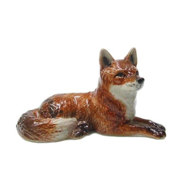 miniature porcelain fox lying down figurine