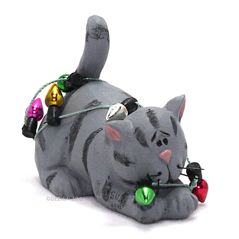 gray cat in christmas lights