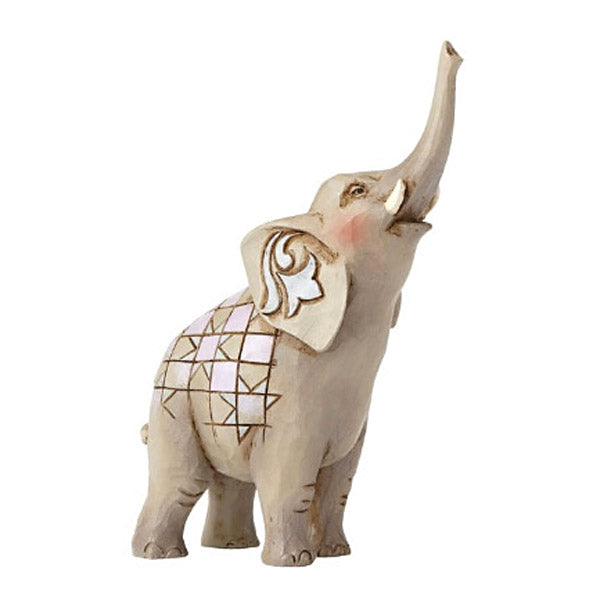 jim shore elephant with trunk raised