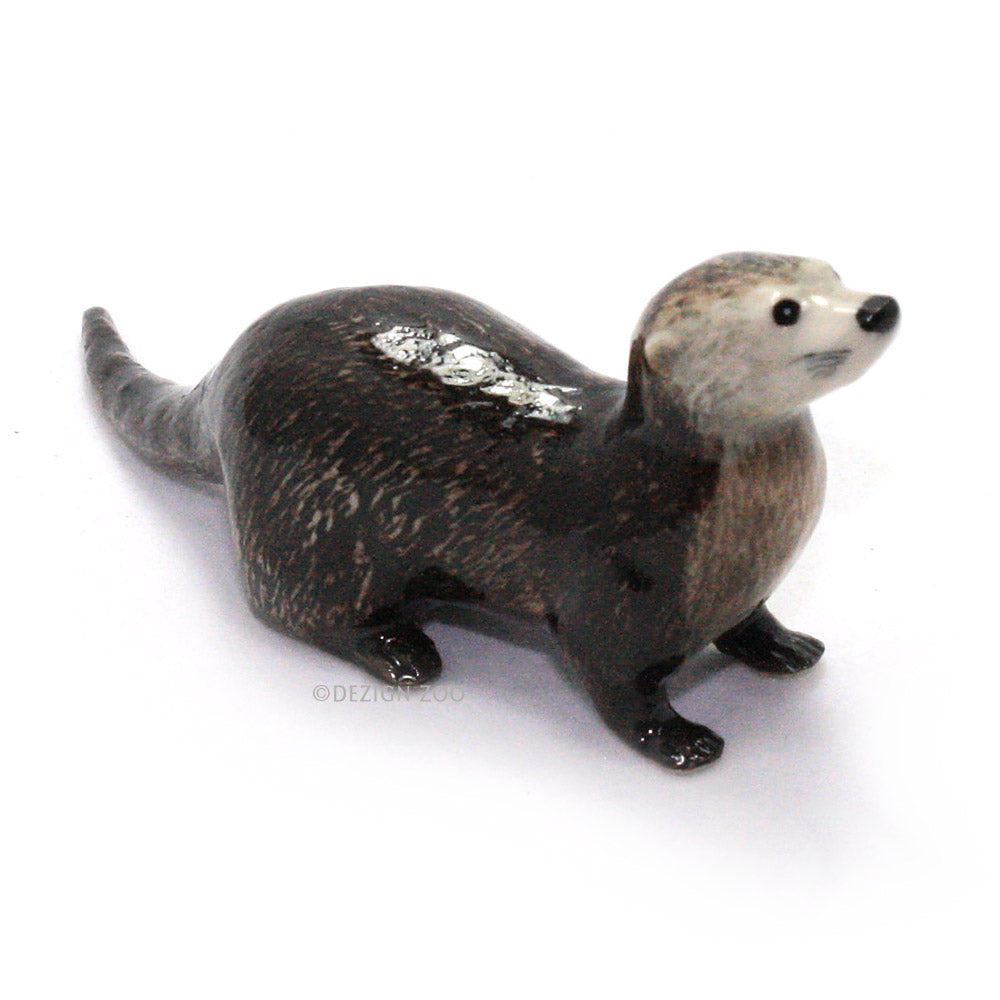 miniature porcelain river otter figurine