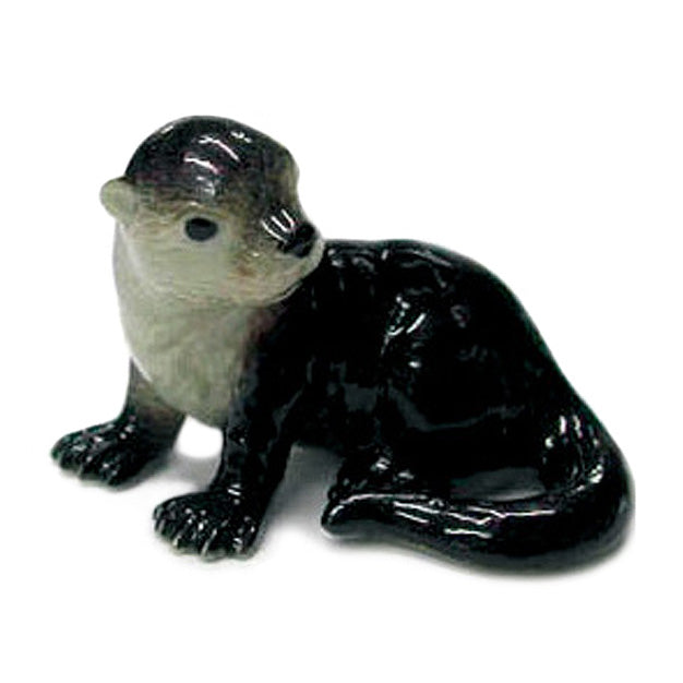 minature porcelain otter pup figurine