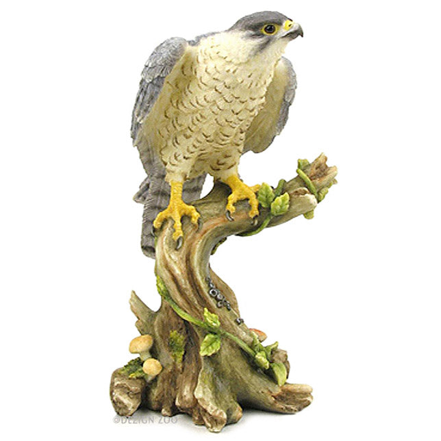 peregrine falcon on branch figurine
