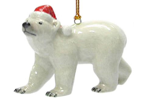 miniature porcelain polar bear in santa hat ornament