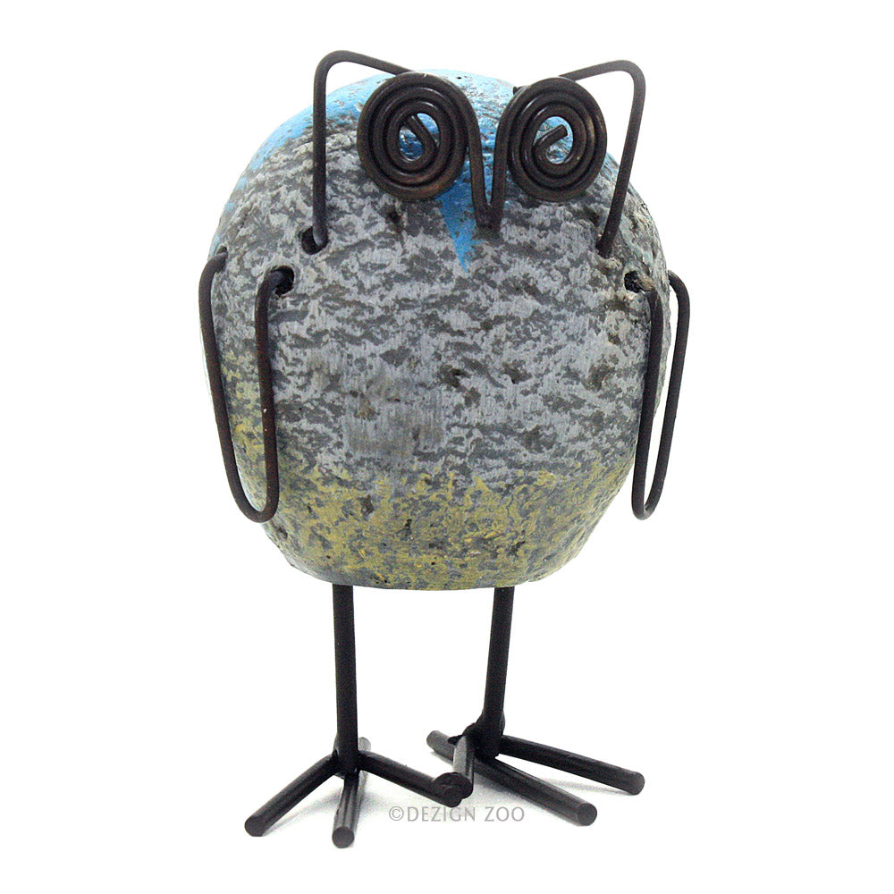 resin rock and metal owl figurine