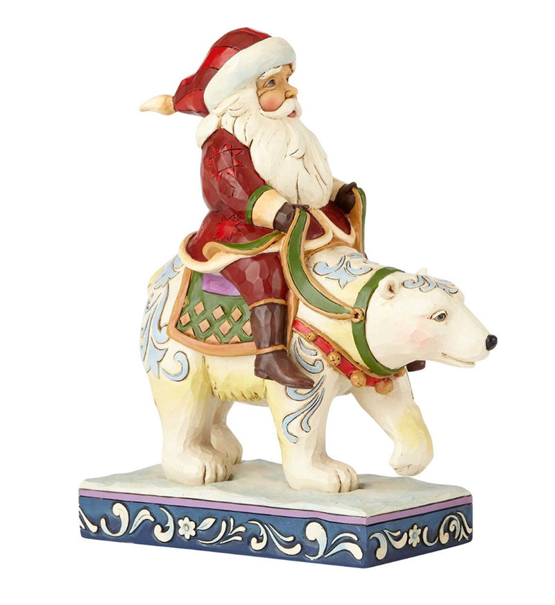 jim shore santa riding polar bear figurine