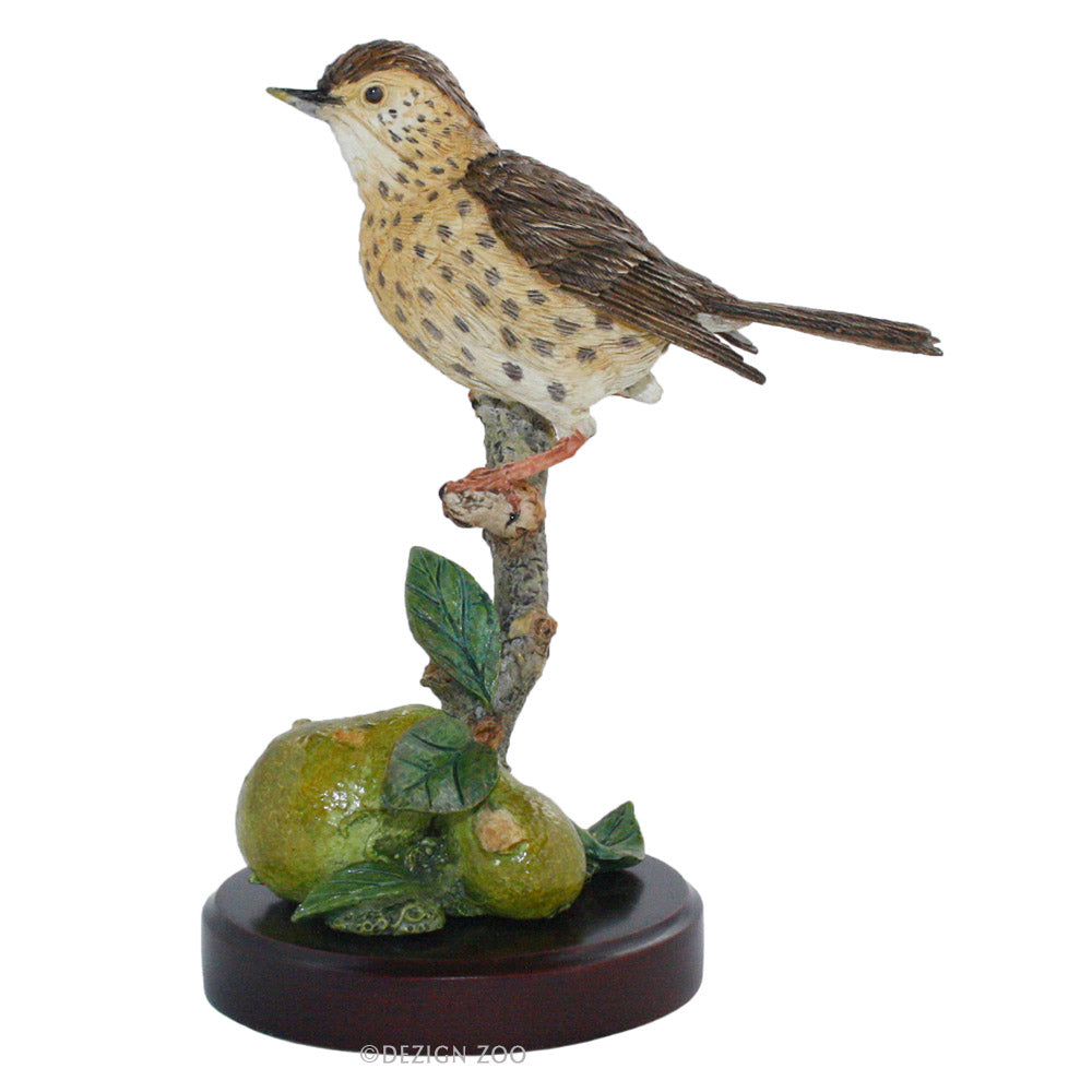 thrush bird on pear figurine