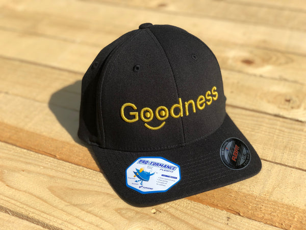 Goodness Smiley Black with Gold Lettering Flexfit Hat